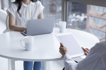 co work: Business people at the office with a laptop