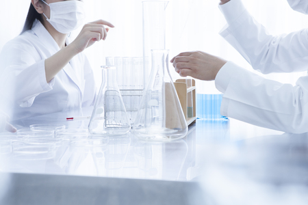 causasian: Laboratory, chemistry and science concept. Science team working in a laboratory.
