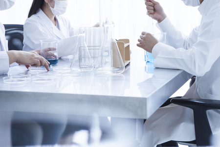 laboratorian: Young scientists in white uniform working in laboratory Stock Photo