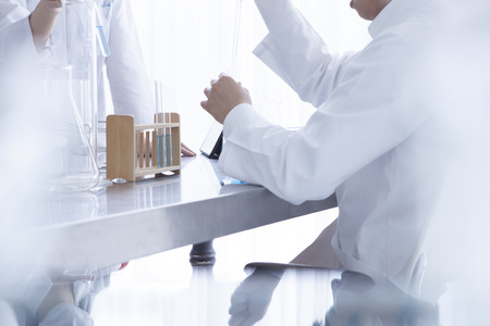 research worker: chemists who have a study of the new drug in the laboratory