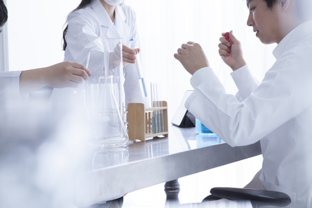 causasian: Three chemists who have a study of the new drug in the laboratory Stock Photo