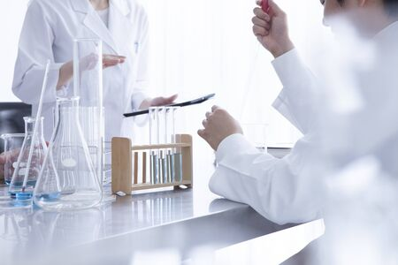 Chemists who have a study of the new drug in the laboratory Stock Photo