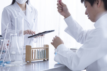 Chemists who have a study of the new drug in the laboratory 写真素材
