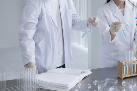 Chemists who have a research of new products in the laboratory