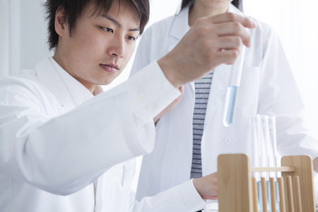 causasian: View of a Scientist and his assistant working in a laboratory