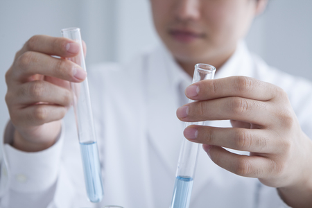 Stock Photo-young, male researcherchemistry student carrying out scientific research in a lab