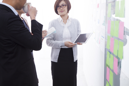 Business women are described using a tablet