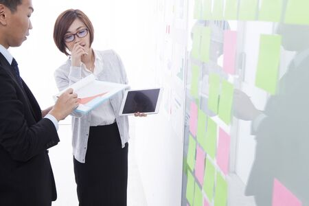 sticky: Business people discussing ideas with adhesive notes in office Stock Photo