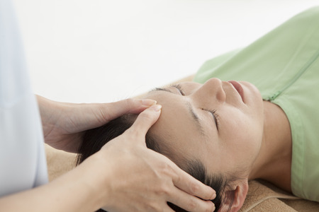 Adult attractive woman receiving head massage