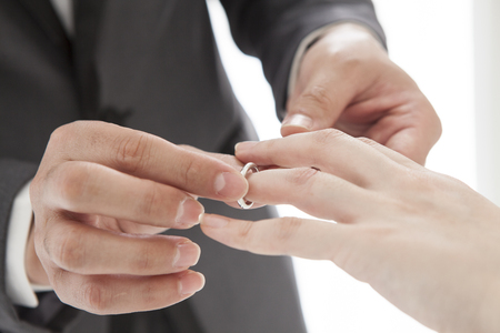 ring finger: Groom to fit a ring on the ring finger Stock Photo