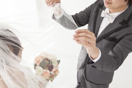 bride veil: Groom to turn the bride veil Stock Photo