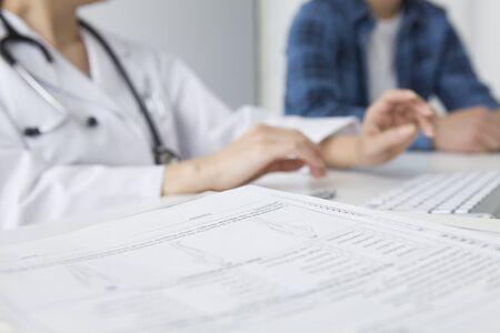 a medical examination: Medical records of patients during examination