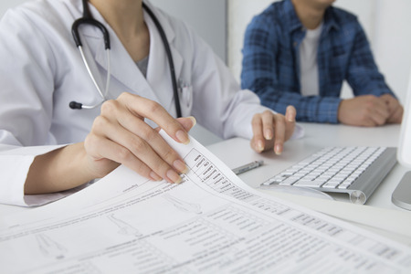 Woman doctor to turn over documents Stock Photo