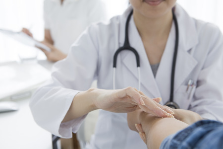 Woman doctor to the medical examination
