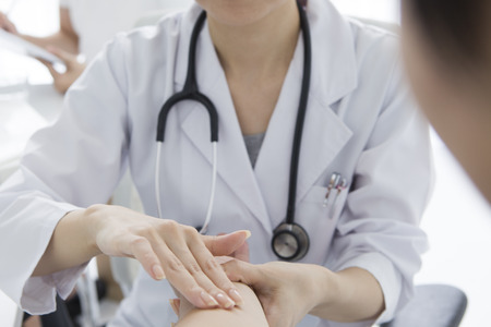 Woman doctor to take a pulse Stock fotó