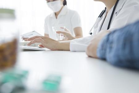 described: Man patient described a woman doctor Stock Photo