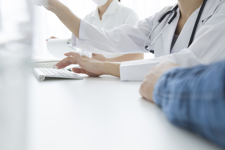 explained: The patient to be explained to the woman doctor Stock Photo
