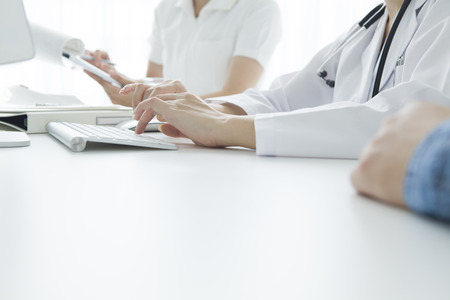 Patients put a hand on the desk