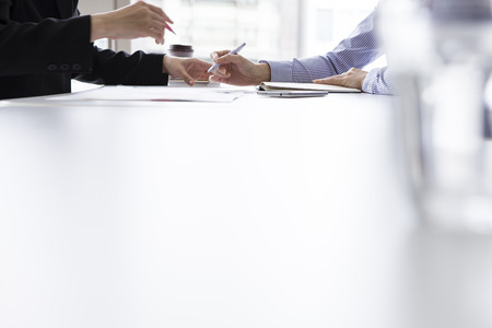 team hands: Two businesspeople, or the businesswoman and client, at office