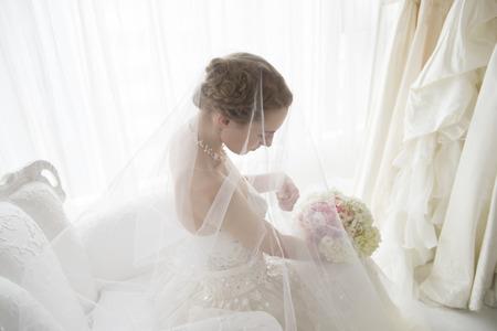 Bride is preparing the wedding in waiting room Archivio Fotografico