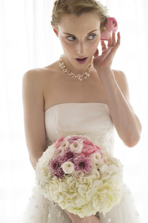 The bride is holding a large bouquet 写真素材