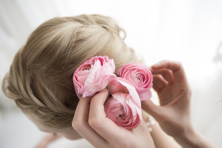 sexy bride: Bride is wearing a flower hair ornaments Stock Photo