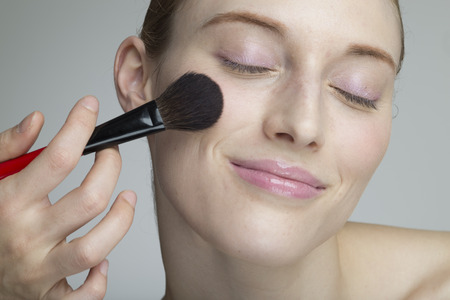 make up artist: Female models that are asked with a blush to the make-up artist