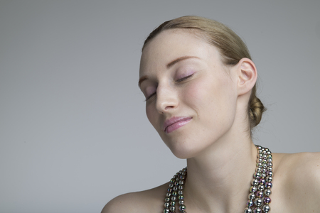 Beautiful woman portrait with closed eyes 写真素材