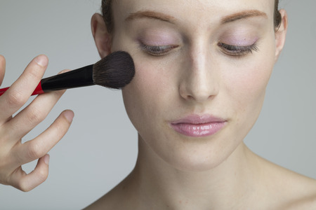 Beautiful female models that are asked with a blush to the make-up artist Stock Photo