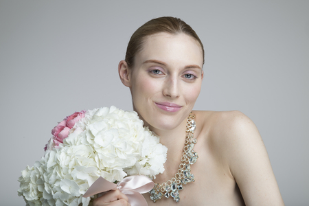 Beautiful woman smiling with a big bouquet 写真素材