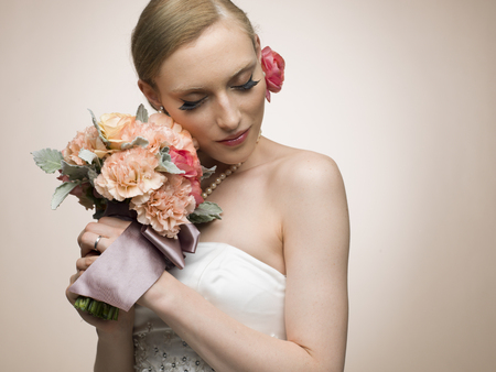 Beautiful bride portrait smiling with a bouquet