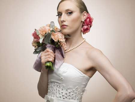 attractive gorgeous: Stylish bride of portraits posing with a bouquet