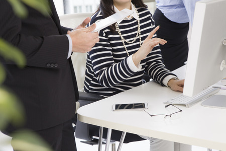 Near the woman, businessman is standing with a tablet