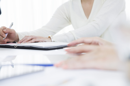 Women are taking notes in the office 版權商用圖片