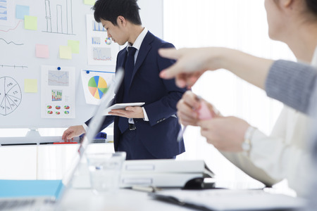 co work: Businessmen are keen on the whiteboard Stock Photo