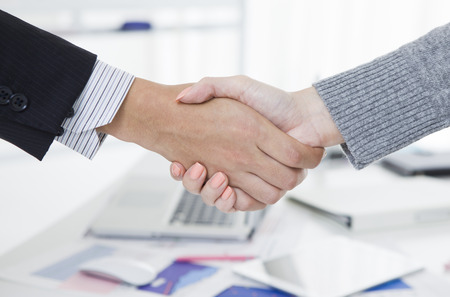 men shaking hands: Business handshake Stock Photo