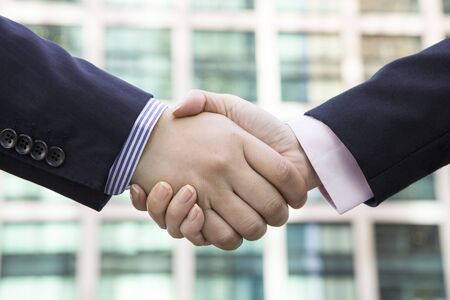 Office workers shaking hands Stock Photo