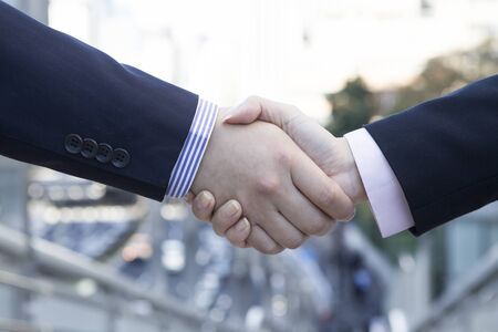 handshaking: Men shake hands Stock Photo