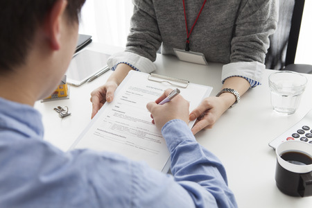 property agent: Man to sign a real estate contract