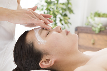 free image: Esthetician to paint the oil around the eyes Stock Photo