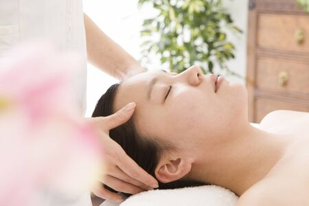 touch: Woman relax in the Head Spa Stock Photo