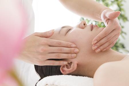 loosen up: Face line massage for women Stock Photo