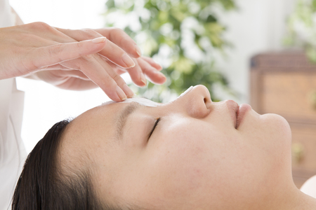 Woman esthetician for a face massage