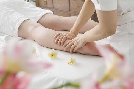 esthetician: Women to the foot massage esthetician