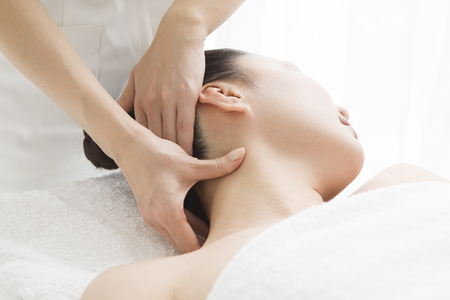 woman back of head: Esthetician for a neck massage