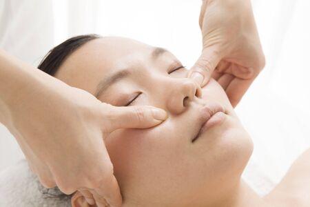 acupressure: Polite face massage Stock Photo