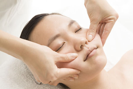 loosen up: Polite face massage Stock Photo