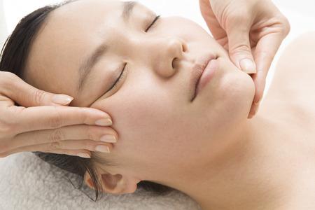 polite: Polite face massage Stock Photo