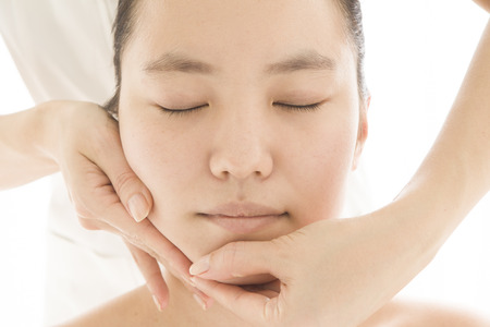 free image: Woman who are holding the chin and cheek