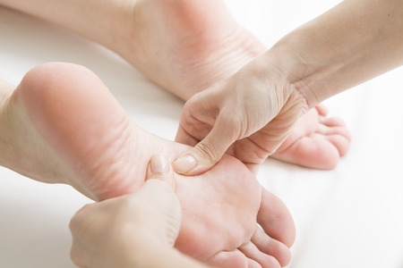 Woman to a foot massage Stock Photo